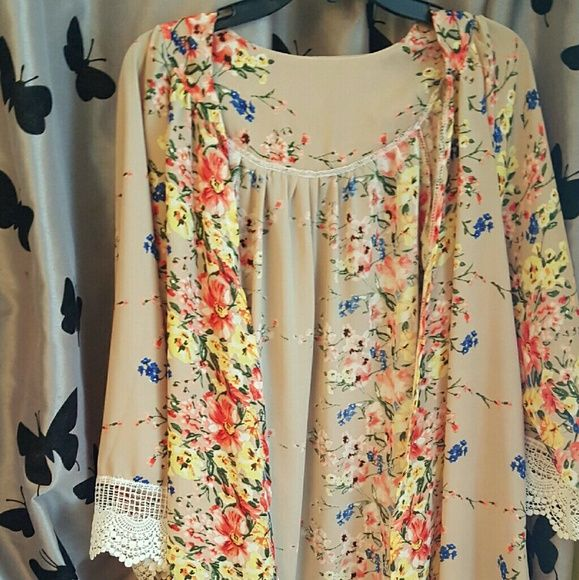 Floral silky cardigan Silky, cool cardigan type top. No buttons/zipper it's made to be front open. Lace on sleeves and bottom. Tops Blouses