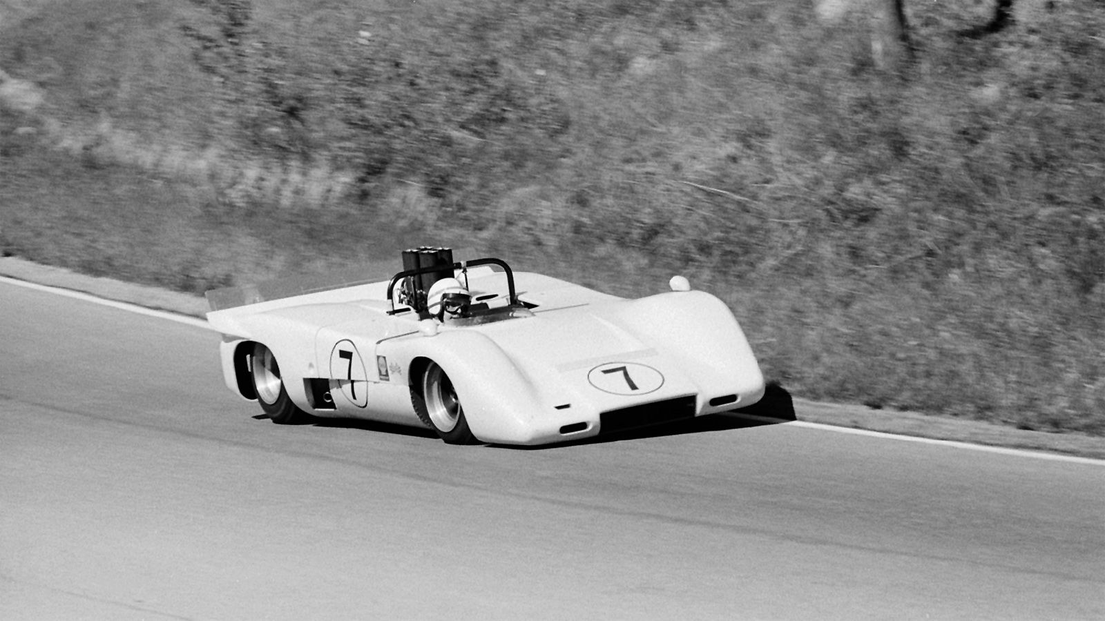 John Surtees Chaparral John Surtees hammers his M12 through turn 7, a left hand sweeping bend at  Mosport
