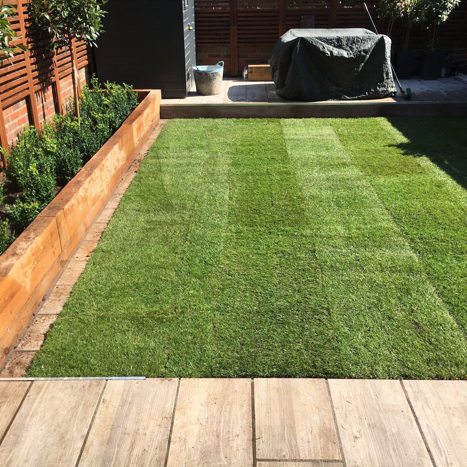 Landscaping Rolawn Medallion Turf laid in this garden New Lawn