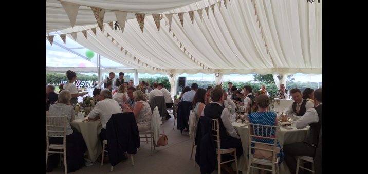 Full draped Marquee with Vintage bunting for a summer themed wedding. provided by Elite Marquees.