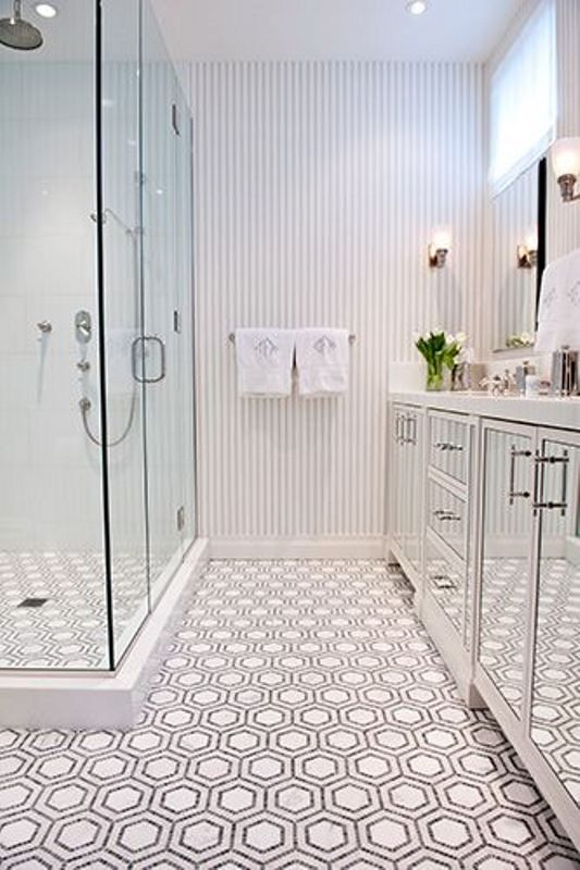 Penny Round Mosaic Tiles In Black And White Are Used To Make A Hexagon Pattern On The Floor Of Small New York Bath Details Like Mirrored Cabinet Doors