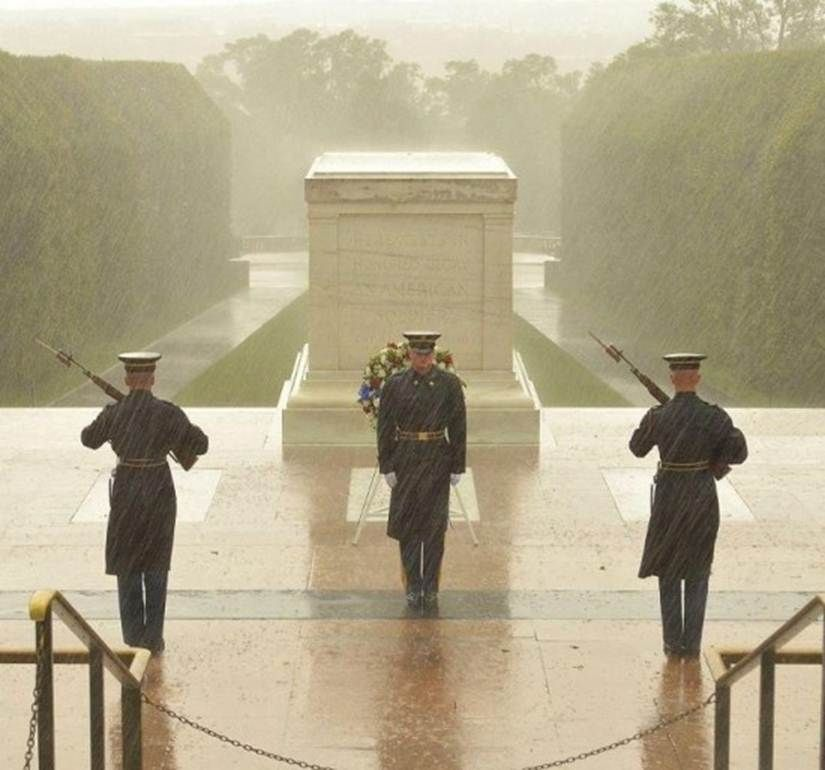 Sentinels at the tomb of the unknown soldier undeterred by Hurricane Sandy. This, my dear people, is what true dedication looks like.