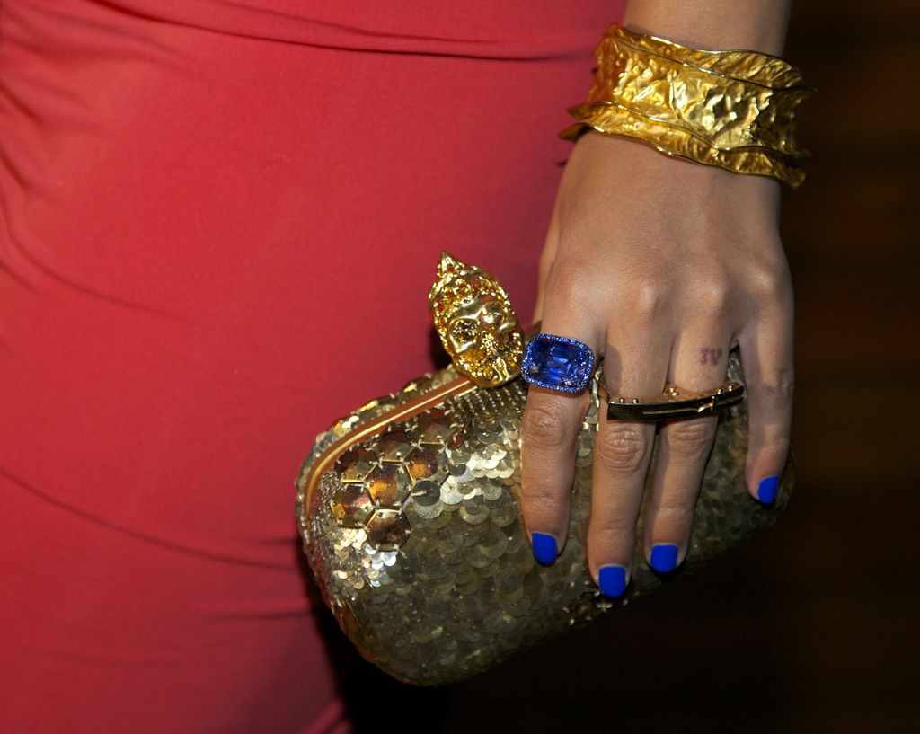 Beyonceus clutch cuff bracelet twofinger ring and nail polish