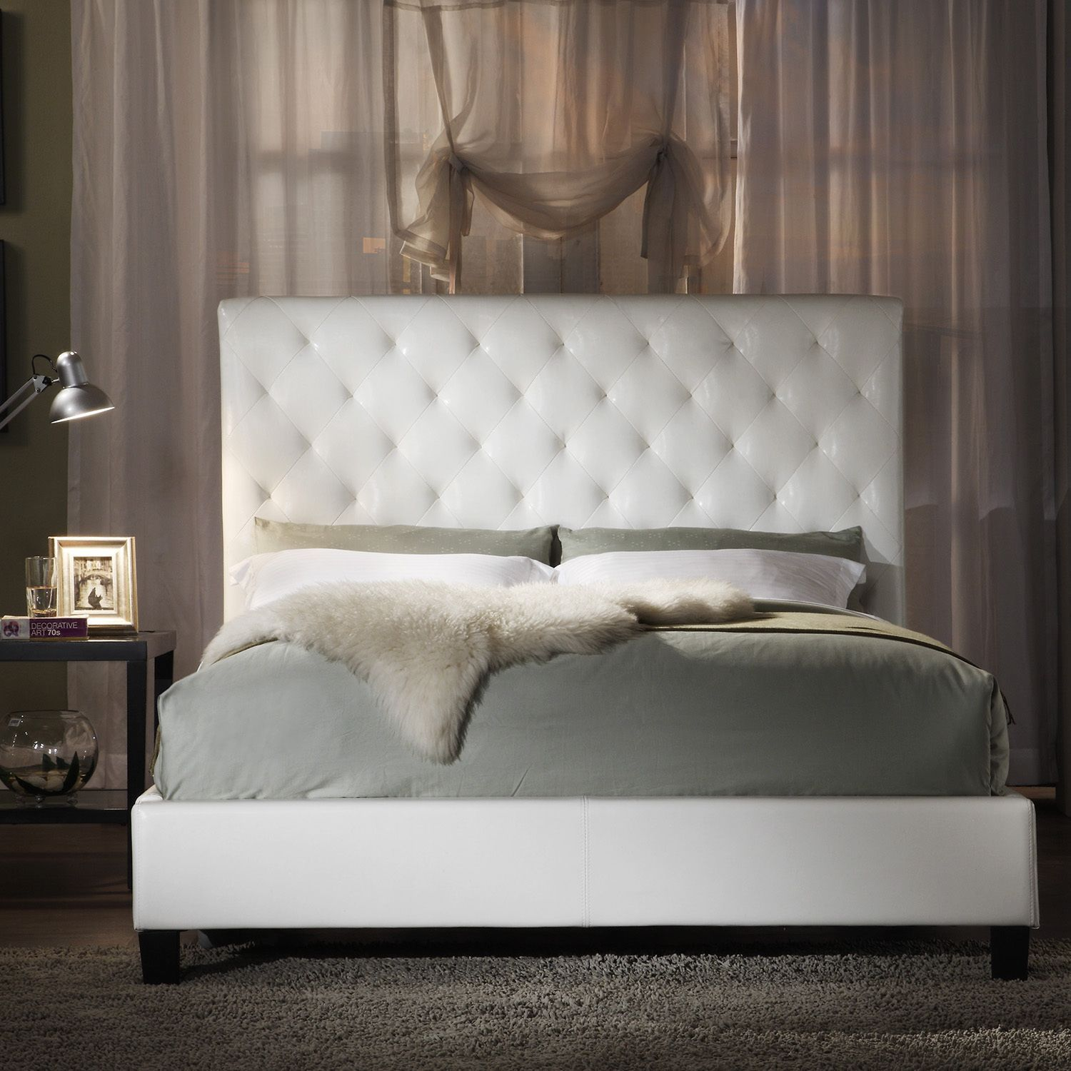 A combination of straight lines and raised features highlight this modern  Sophie white bonded leather king