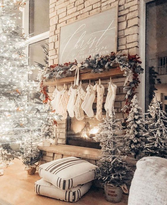 christmas decor with flocked trees and red accents, fireplace mantel decorated for christmas, vaulted ceilings | Nina Williams Blog