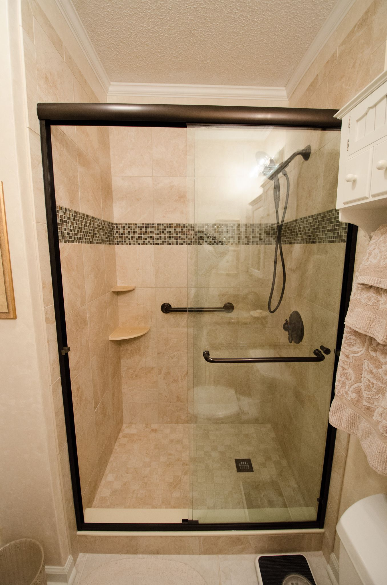 Glass, Walk In Shower, Dual Grab Bar, Corner Shelves, Tile Feature