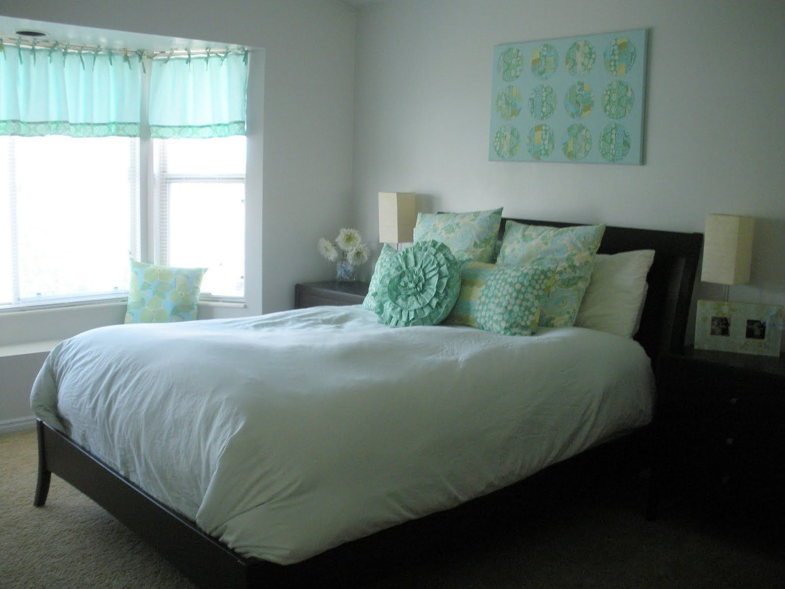 love a white bedspread with color in the accents/pillows