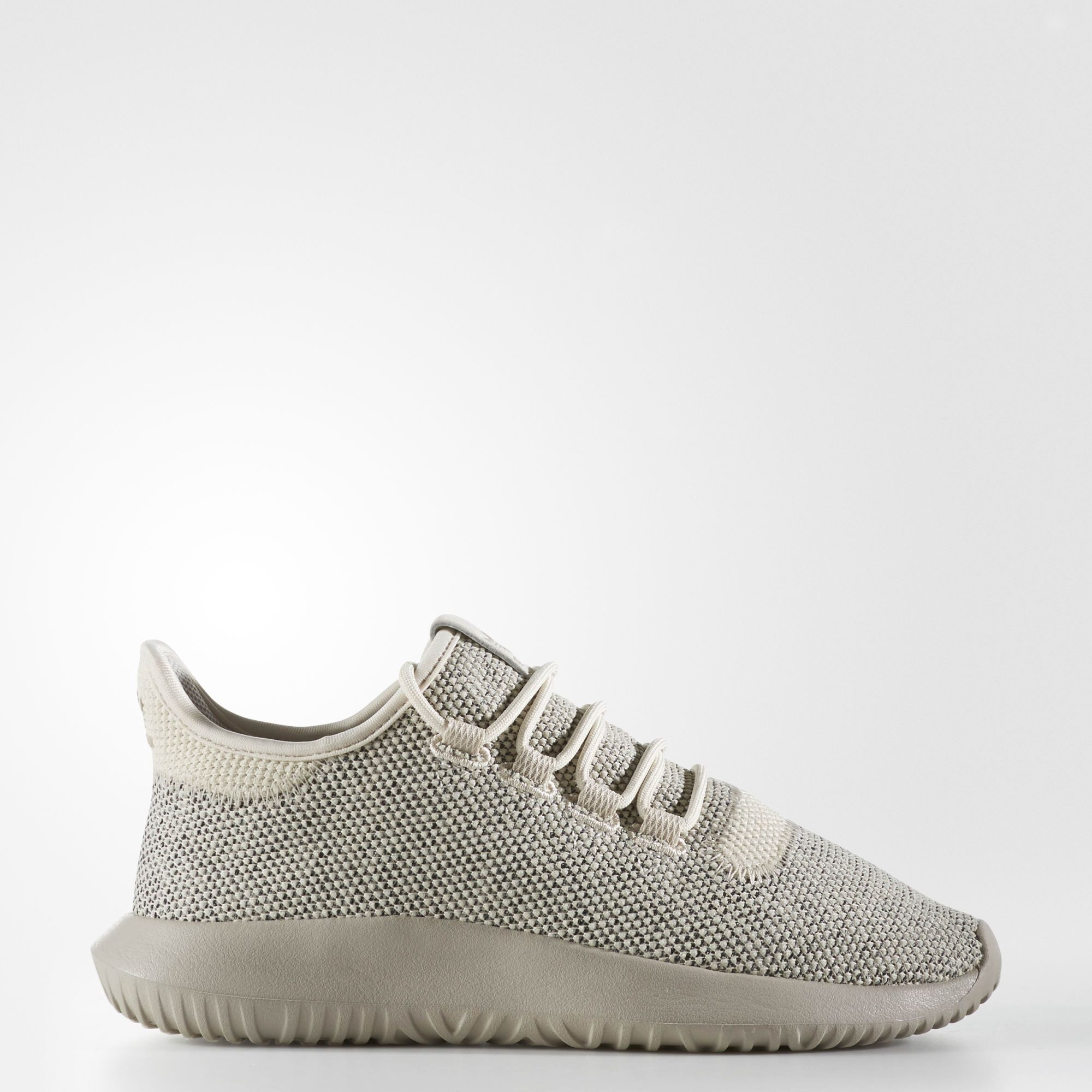 An edgy, future-focused take on adidas running-inspired heritage, these juniors' Tubular shoes redefine street style with an identity all their own. They're made in mélange knit material with an allover 3D diamond pattern. An innovative fold-over tongue design gives them a comfortable fit.