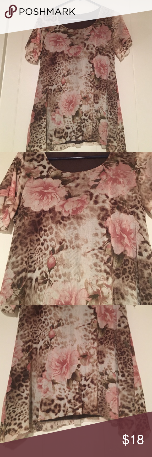 Earthy colored flowered blouse Earthy color with pink roses with cheetah prints throughout. Longer sides. Light flowy material. Short sleeve. Excellent condition. Not anthropologie Anthropologie Tops