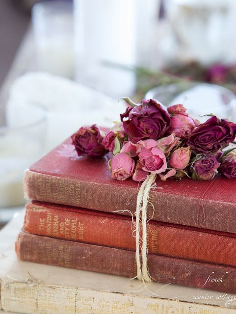Displaying old books, wrapped with twine and dried flowers. FRENCH COUNTRY COTTAGE: Collecting books