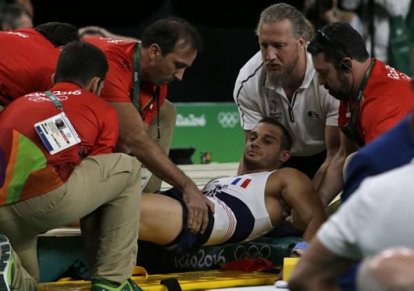 France's Samir Ait Said is assisted after injuring his leg in the vault during the artistic gymnastics men's qualification at the 2016…