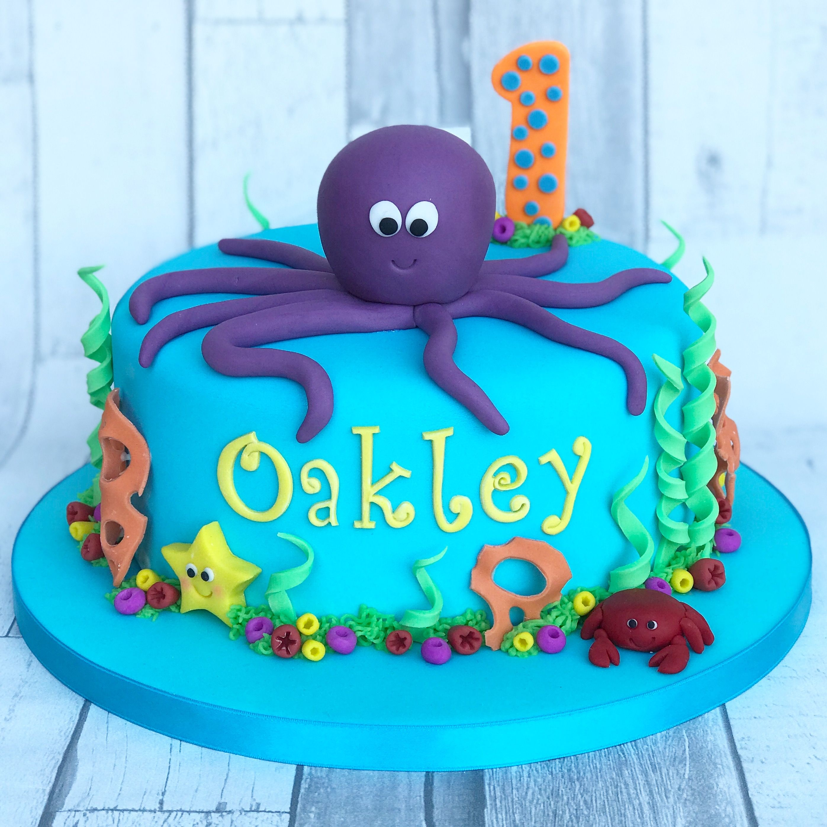 A Under The Sea Cake Complete With Purple Octopus Crab Star Fish Coral Ocean Birthday Cakes Boy Birthday Cake Boys First Birthday Cake