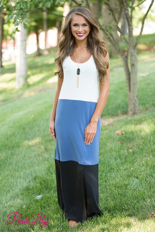 This beautifully breezy maxi is simply perfect for relaxing while on vacation - or even on a late summer stay-cation! Featuring a colorblock style in black, sapphire blue, and white, this classic color combination is simply perfect!