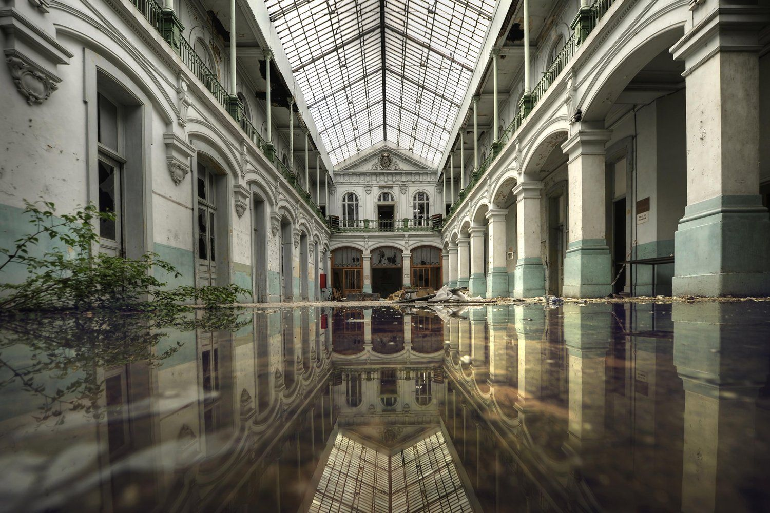 The hallway of this old school, found by decay photographer Andre Govia, has almost become a swimming pool..