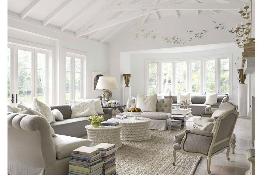 I love all the grey in this room, especially that Bergere chair...