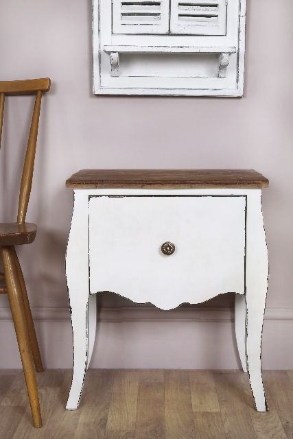 A Distressed White Bedside Table Or Lamp Table That Has A Natural