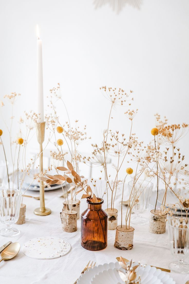 Love these dried flower wedding centrepiece ideas. Cost effective and adorable. For more unconventional wedding ideas visit www.bridedisrupted.com