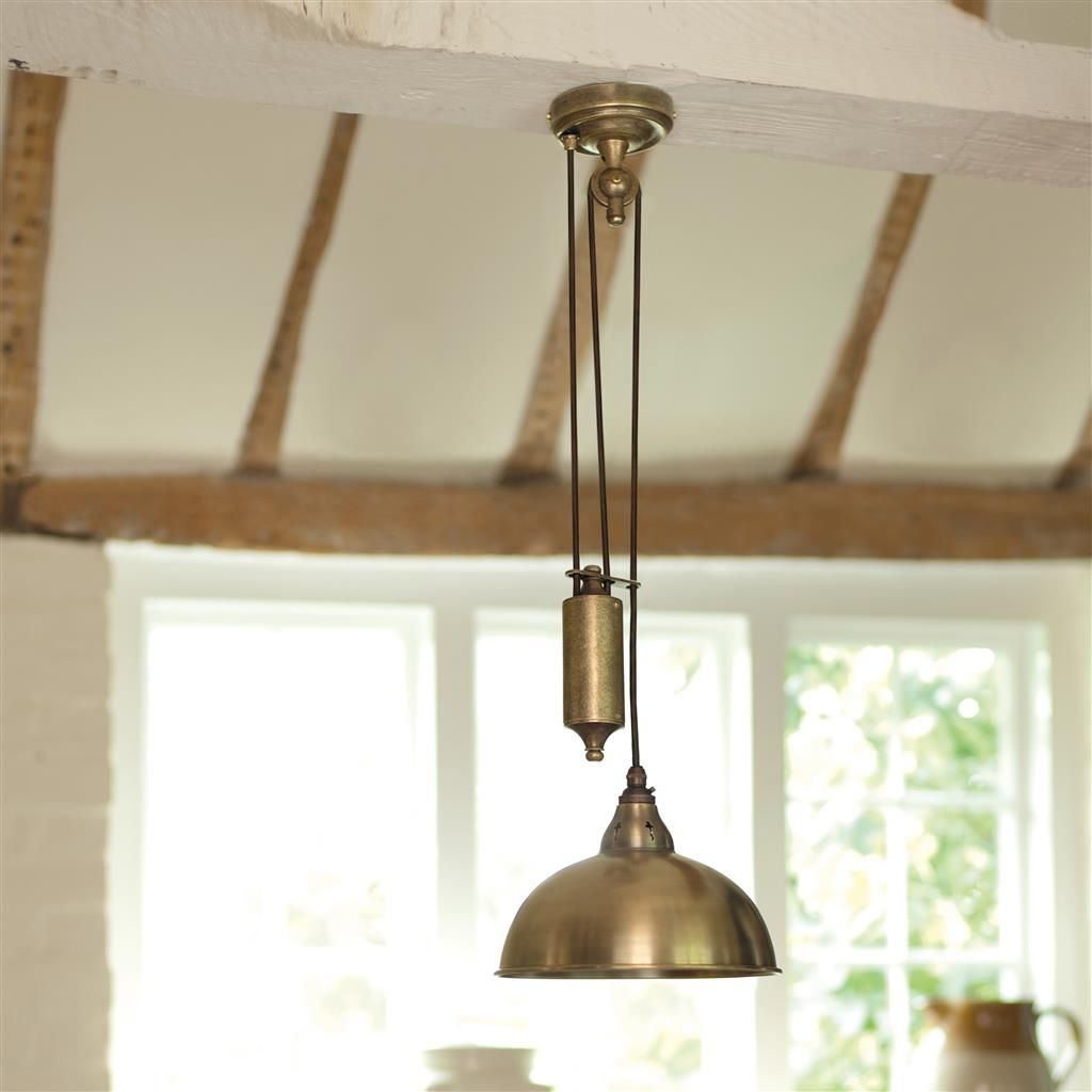 Butler rise and fall pendant light in antiqued brass for Brass kitchen light fixtures