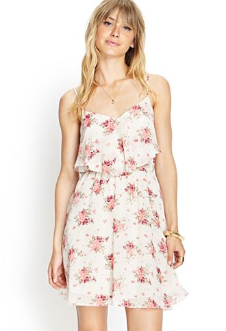 Love 21 - A woven cami dress featuring a rose print and flounce bib layer.