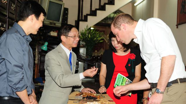 He visited traditional medicine shops in Hanoi's old quarter (Kensington Palace/PA)...