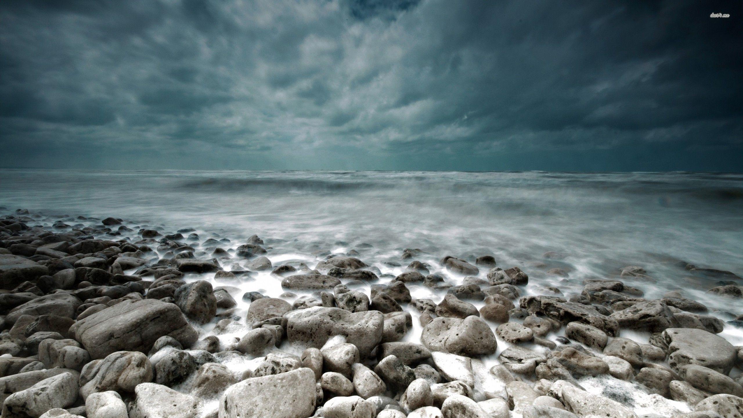 Beach Thunderstorm Wallpaper: Storm-brewing-over-the-rocky-beach-wallpaper-wallpapers