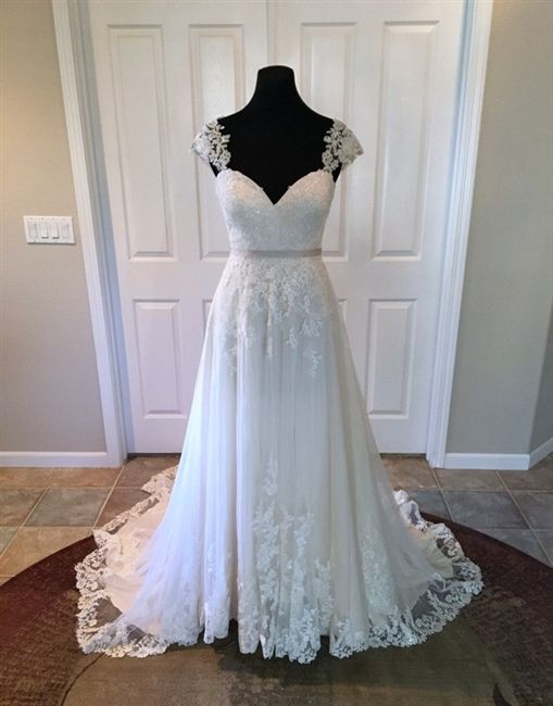 """Pretty Lace Wedding Dress! 2016 Lace & Tulle Over Satin A-Line Gown with a Sweetheart Neckline, Lace Cap Sleeves, Lace Fitted Bodice with a Detachable 1/2"""" Ribbon Belt at Natural Waistline, Lace Applique Through A-Line Skirt with Lace Hemline, Chapel Train, Illusion Lace High Back Over Low V-Back Interior with Covered Buttons Over Hidden Zipper. #illusionlaceback #lacebackweddingdress #laceweddingdress #romanticweddingdress #capsleevewedding #dreamwedding #bride #bridalgowns #sweetheart…"""