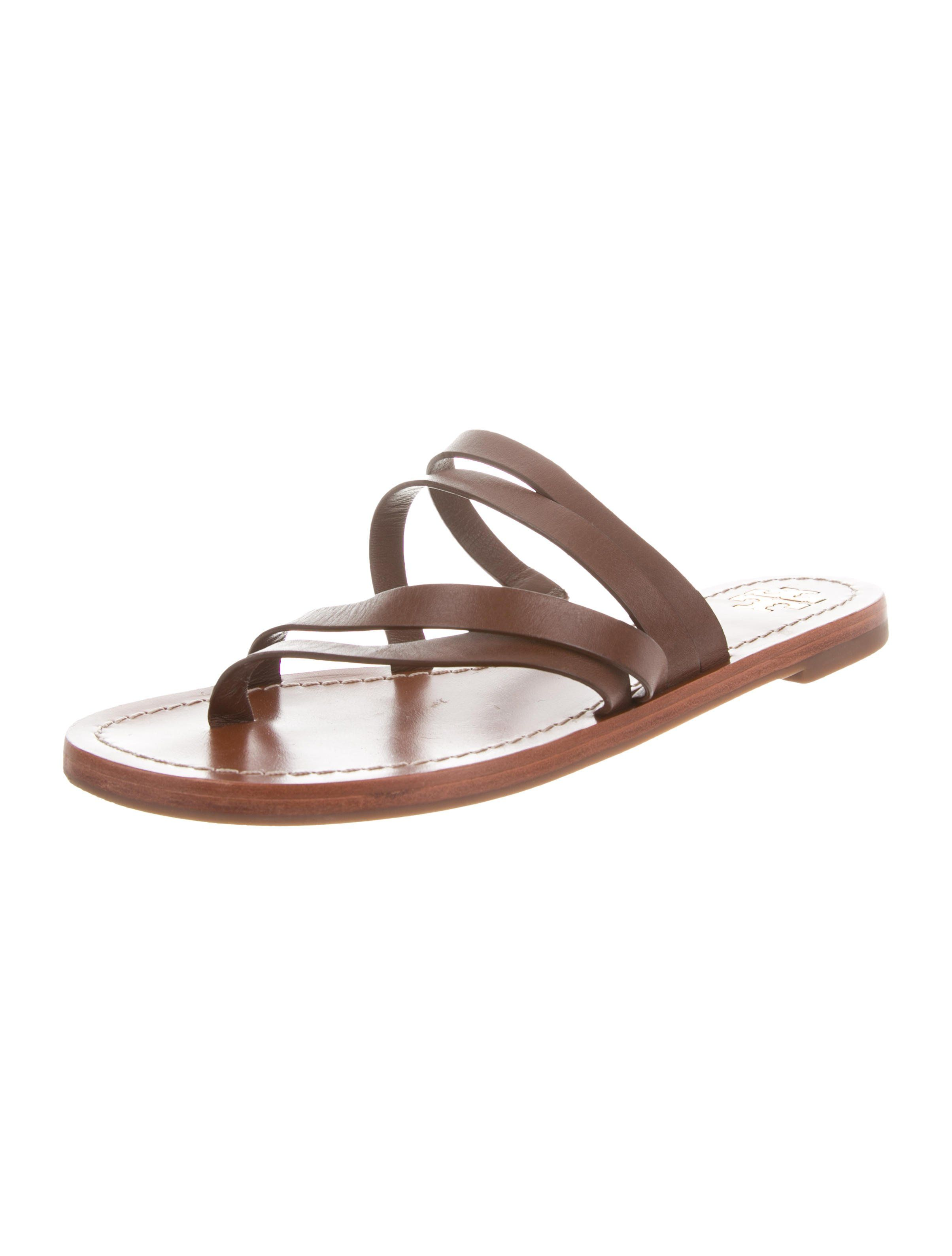 52a5ba5f4 Brown leather Tory Burch slide sandals with crossover straps and rubber  soles. Includes dust bag