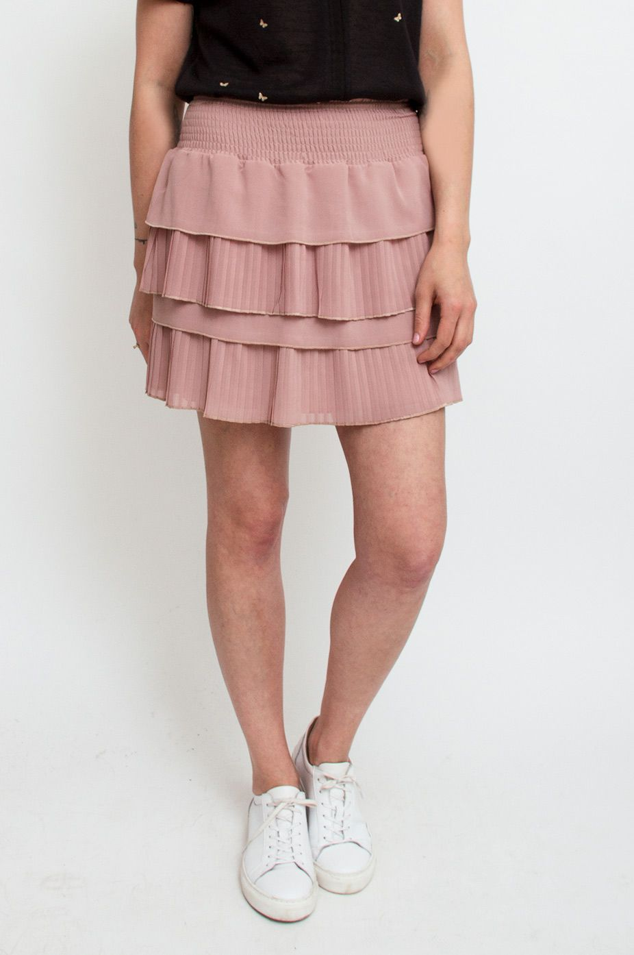 This nude miniskirt, cut in a pleated style, features gathered fabric at the waist for a playful and flattering effect. We like it worn with a bomber jacket for a fresh, sporty look. By Neo Noir.      Available at Sienna and Sienna & Lois.