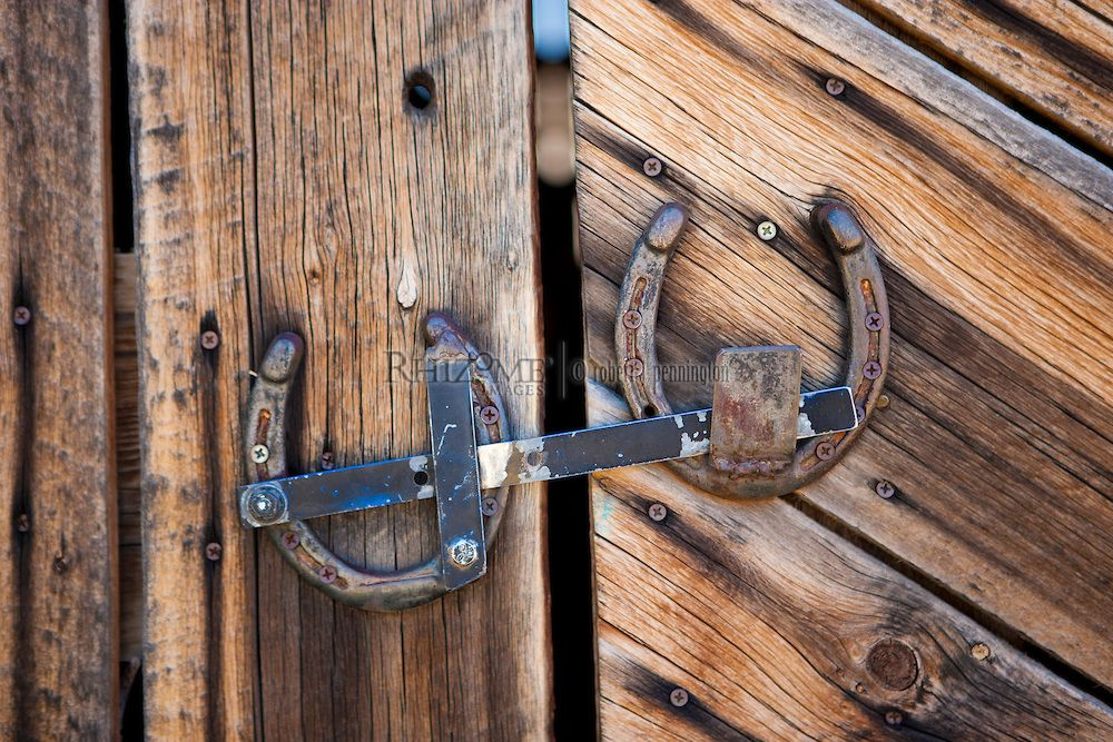 Western Barn Door With Homemade Latch Made Out From Old Horseshoes