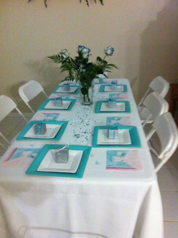Table Set Up Plates Napkins And Congratulations Signs Are From