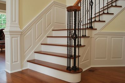 stairwell molding - wainscoting and column.  I especially like the horizontal molding added in the center of the column