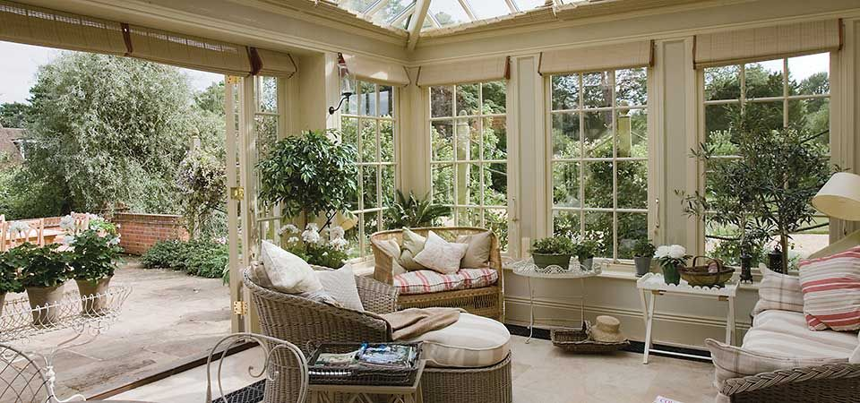 Conservatory living sunny spaces and potting places for Conservatory interior designs