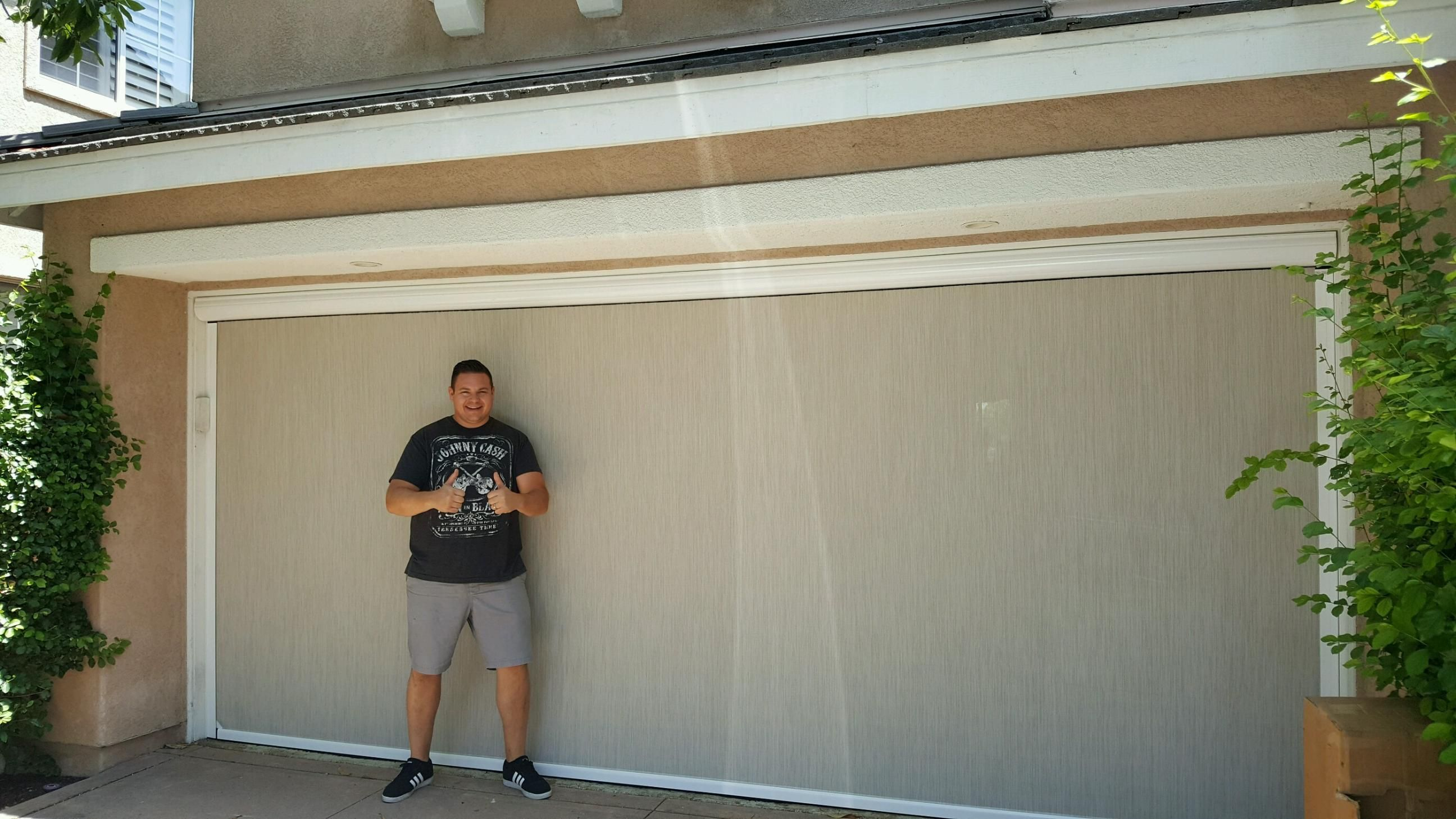 Look At How Happy This Homeowner Is With His New Motorized Power Screen Our Installers Just Finished Putting Over His Garage Screen Door Garage Doors Homeowner