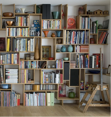 bookshelves wall - I love the different sizes of the shelves and the  spacing!