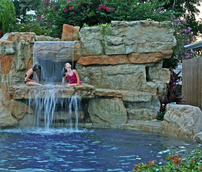 Orlando Pools By Design contemporary_classic_pool_design_spa_sunshelf_with_bubblers_travertine_deck_travertine_coping_and_tahoe_pebble_interior Recent Projects Orlando Florida Custom Cave And Swimming Pool Waterfall