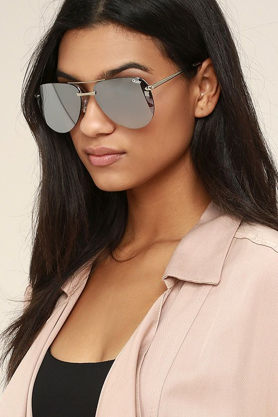 The beach is where the Quay The Playa Grey and Silver Mirrored Aviator Sunglasses belong! Shiny silver accents grey mirrored lenses for a modern, frame-less look. Protective case included. 100% UV protection.