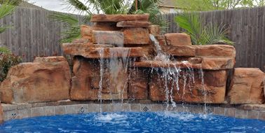 Ricorock Inc Is The Industry Leader For Artificial Rock Waterfalls - Swimming-pool-designs-with-waterfalls
