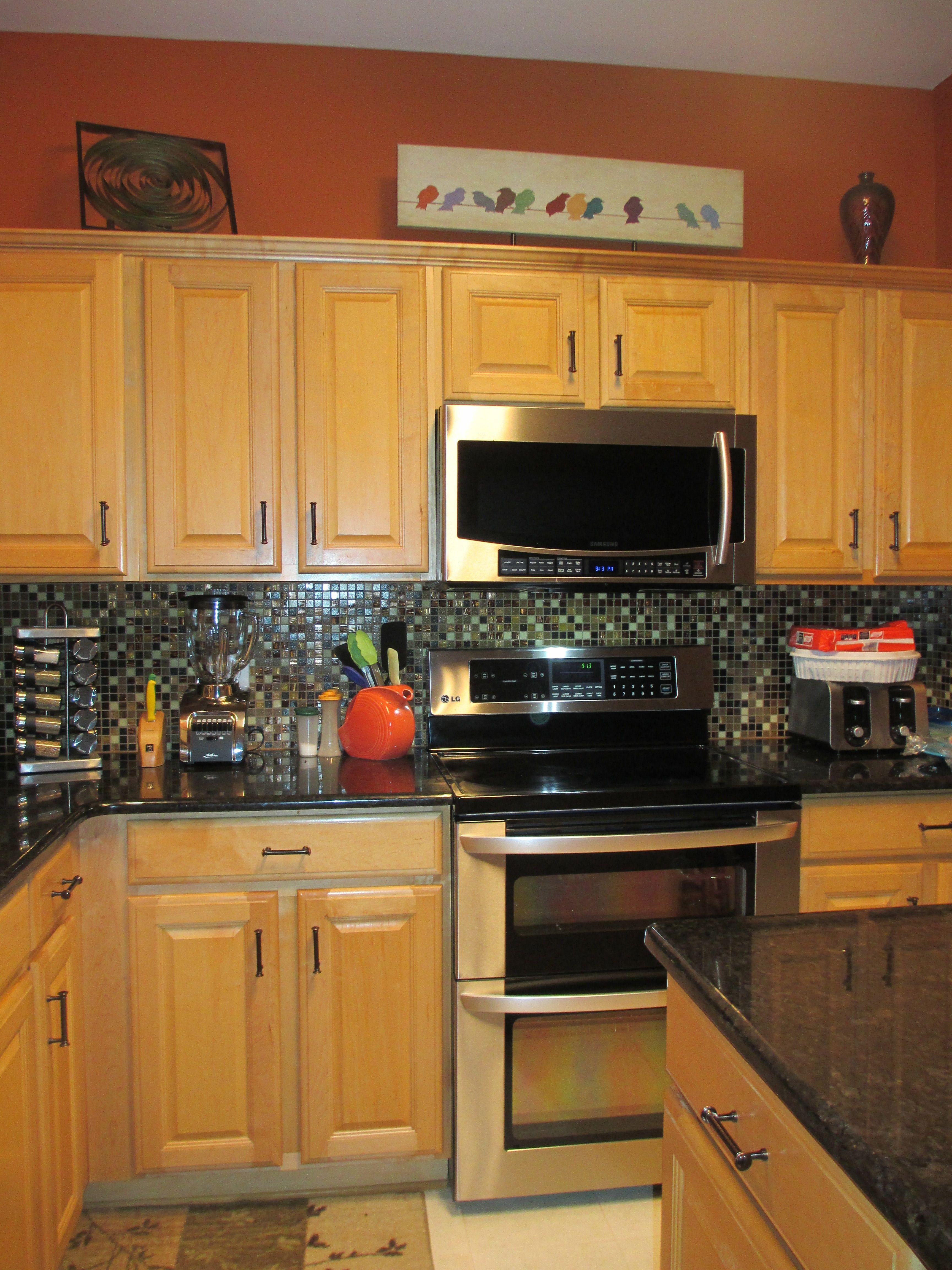 Burnt Orange Kitchen With Black Pearl Granite Countertops Orange Kitchen Decor Orange Kitchen Walls Burnt Orange Kitchen Orange countertops in kitchen