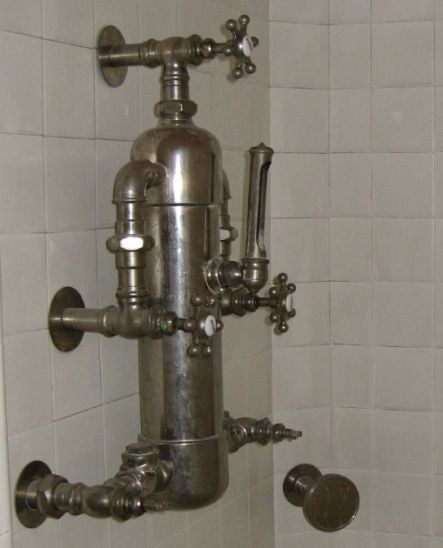 Awesome steampunk shower fixture. I imagine the water heater to be ...
