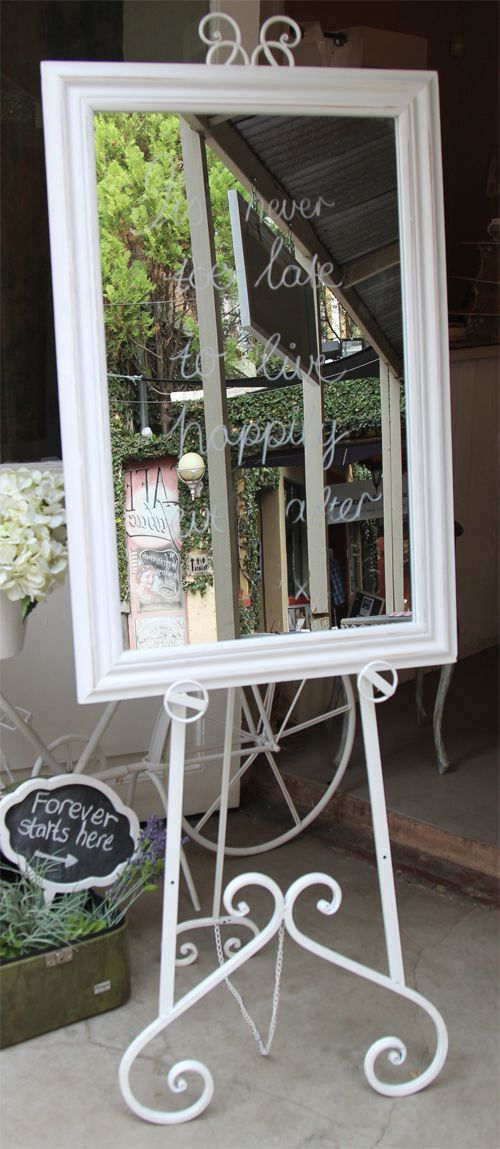White Easel And White Wooden Frame Mirror To Rent From Moi