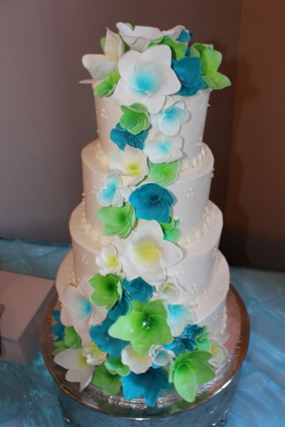 lime green and blue wedding cakes malibu blue and lime green flowers cascading a four 16894