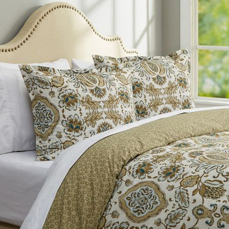 Dress your bed in resort-worthy elegance with this eye-catching duvet cover set, showcasing a bold floral motif in beige.   Product:...