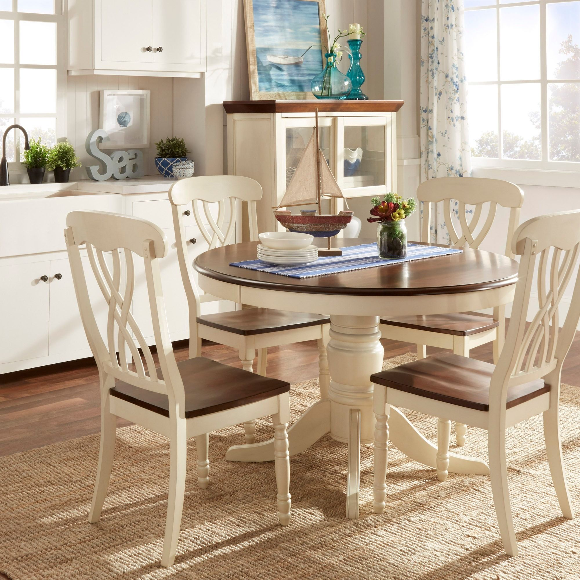 The design of this 5 piece dining set from mackenzie for Country style dining room sets