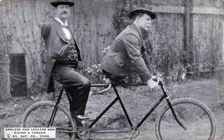 Charles B. Tripp, the armless man and Eli Bowen, the legless man, riding a tandem. 1890s