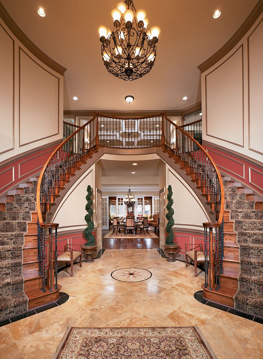 Dual Staircase Foyer : Grand two story foyer with dual staircase and