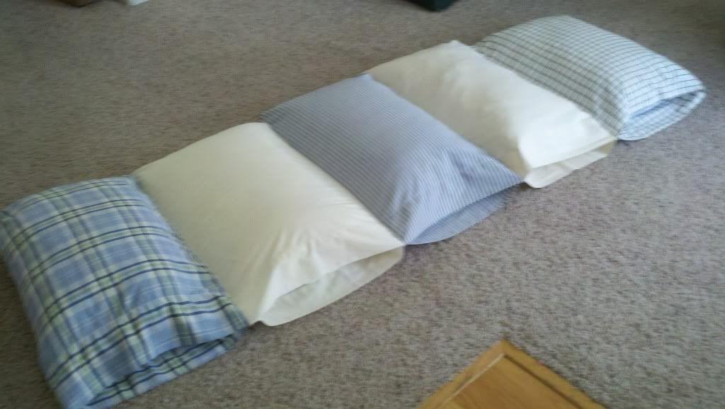 5 pillows, 5 pillow cases- instant fold up sleep mat/bed.