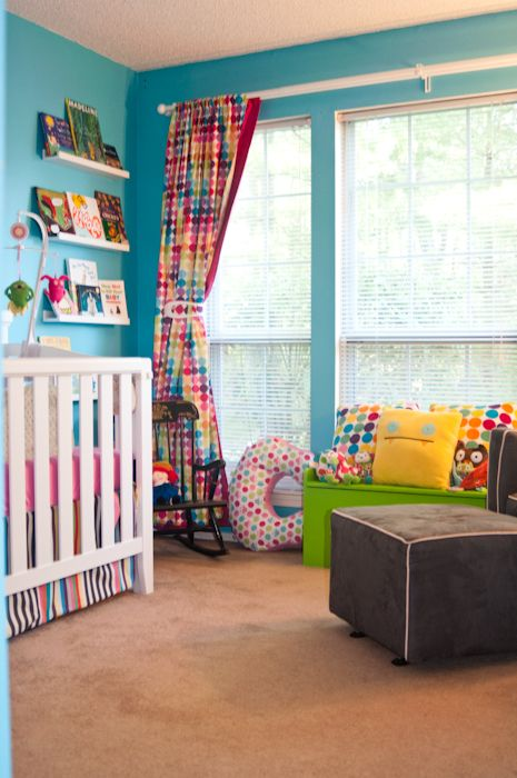 Love the curtains and the bright pillows Colorful Nursery Ideas
