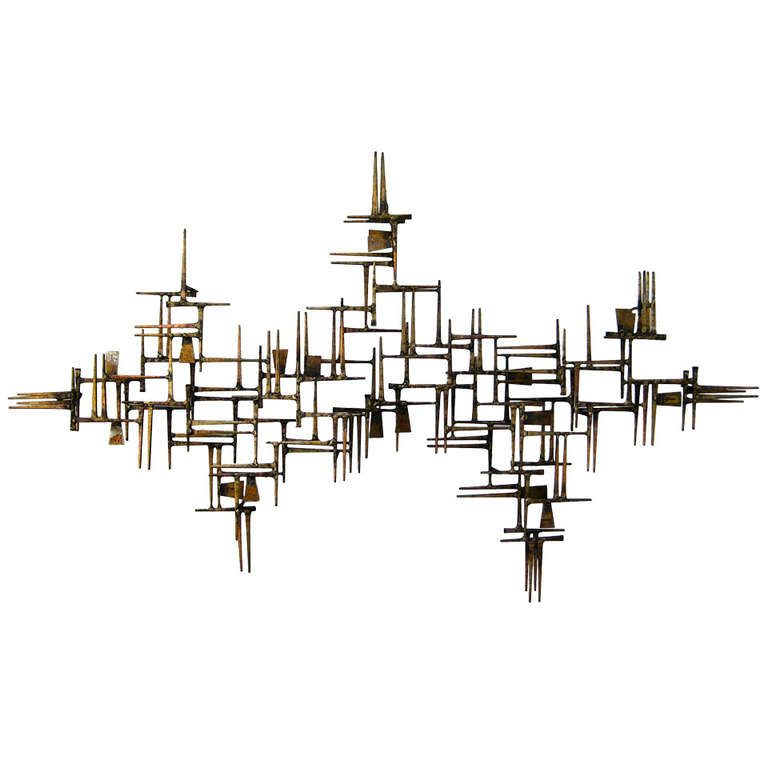 a powerfully composed braised and gilded william bowie wall sculpture circa 1960s