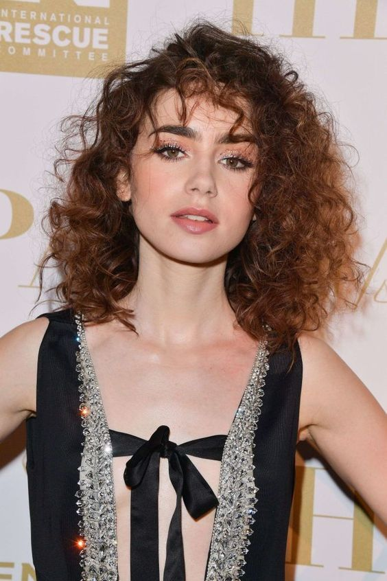 The 19 Coolest Curly Hair Bangs From Pinterest Curly Hair Styles Curly Hair Styles Naturally Lily Collins Hair