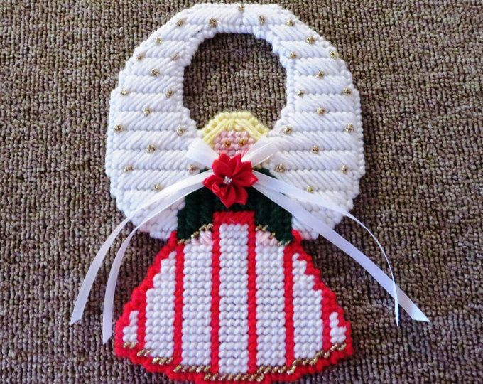 Survivor needlepoint ribbon angel ornament. Approximately 5 in. Made in the USA by small business and not mass produced. I very much appreciate your interest.